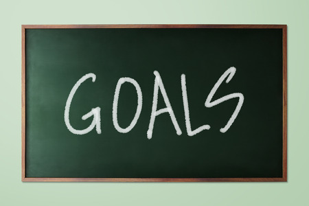 representations: Hand drawn Goals, business concept on green chalkboard