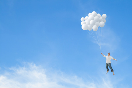 lifted: Man lifted into sky by huge bunch of white balloons