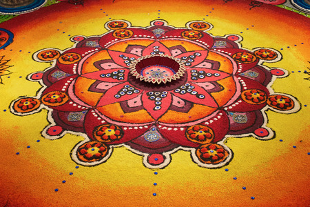 red oil lamp: Deepak with colourful rangoli