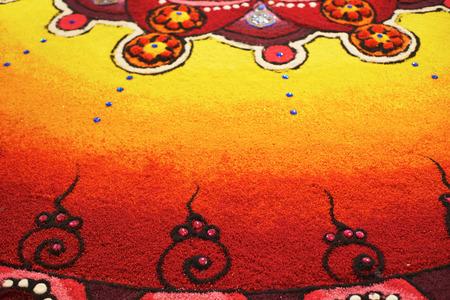Deepak with colourful rangoli