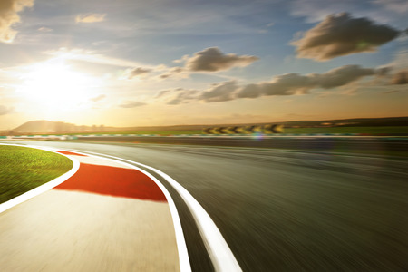 race cars: Motion blurred racetrack,warm mood mood Stock Photo