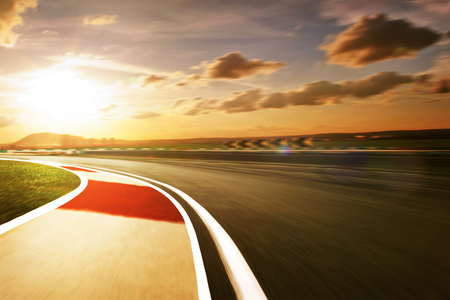 race cars: Motion blurred racetrack,sunset mood mood Stock Photo