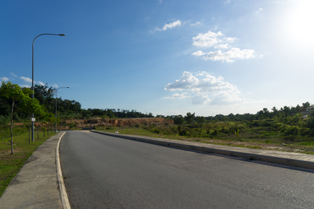 seson: asphalt road with blue sky Stock Photo