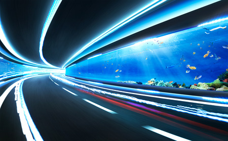 express lane: Abstract blurred speed motion road in glass tunnel underwater,with light trail Stock Photo