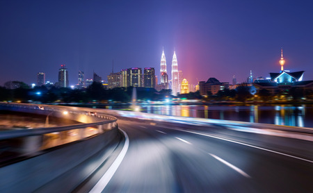 Highway overpass motion blur with city background .night scene