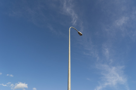 lamp on the pole: blue sky with white lamp pole
