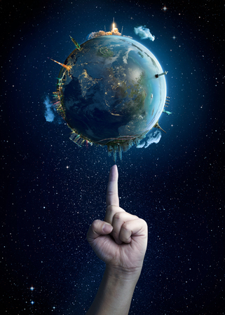 ecosavy: Mans hand touching the Earth.