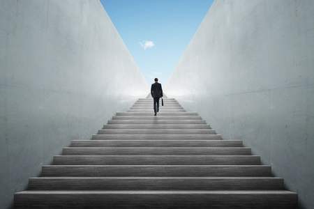 ambitions: Ambitions concept with businessman climbing stairs Stock Photo