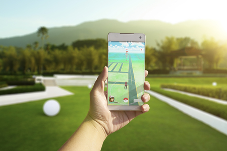 real world: Kuala Lumpur, Malaysia - August 12, 2016 : Pokemon Go is a new augmented reality game which lets you walk in the real world to catch the Pokemon.