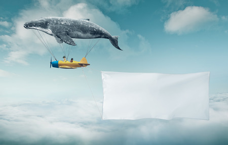 Blank white banner with a copy space area hanged up from fantasy air plane Stock Photo