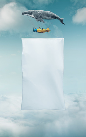 space   area: Blank white banner with a copy space area hanged up from fantasy air plane Stock Photo
