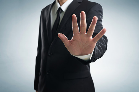 limitations: Hand stop shown by businessman.