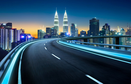 Highway overpass motion blur with city background . night scene . Stock Photo