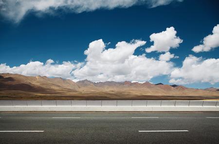 vanishing point: Empty asphalt road and mountain background . Stock Photo