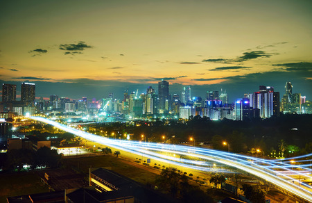interchanged: Abstract and car lighttrail  background, city skyline downtown background and highway interchanged nigh view . Stock Photo