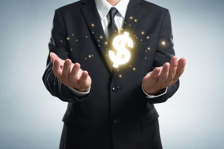 dollar symbol: Businessman holding  dollar symbol.