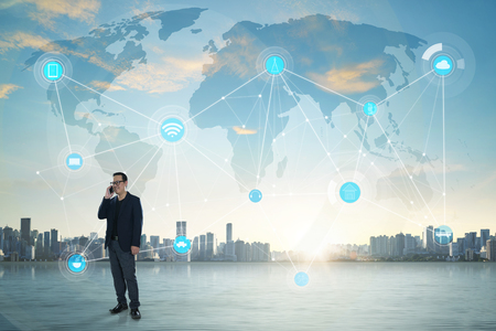 international internet: International business concept with businessman on city skyline background with network on map and sunlight