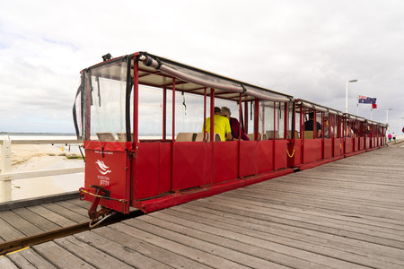 busselton: PERTH, AUSTRALIA - NOVEMBER 11 2016: Busselton Jetty Train, the Busselton jetty is the longest wooden jetty in the southern hemisphere.