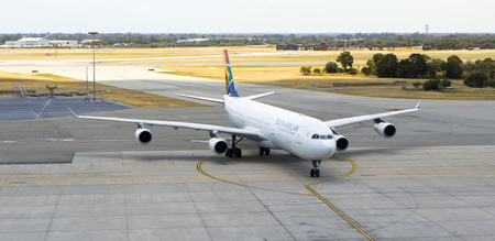PERTH, AUSTRALIA - NOVEMBER 12,2016 : South African Airways Airbus A340 taxies on Perth airport in an Olympics color scheme, on November 12 2016 in Perth, Australia. Editorial
