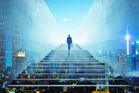 Rear view of a businessman climbing stairs to get to a large city center. Concept of success and appreciation. Double exposure Stock fotó