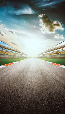 View of the infinity empty asphalt international race track, digital imaging recomposition montage background . evening scene .