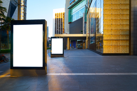 street signs: Two blank advertising stand at early morning against office building. Stock Photo