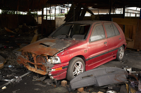 burned out: Burned out cars in garage after fire ,for car insurance propose use . Stock Photo