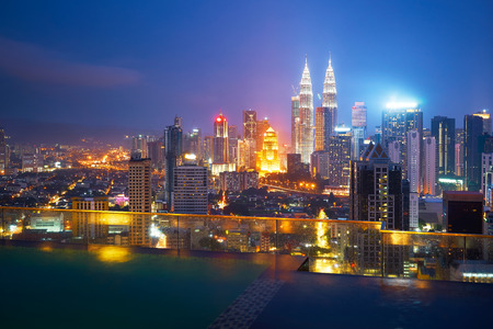 After the rainy night, in the roof top of the swimming pool with beautiful city skyline view ,Kuala lumpur, Malaysia.