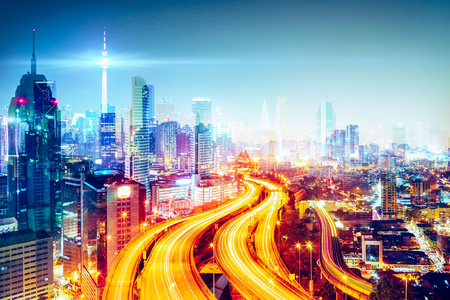 Modern city skyline and futuristic city skyscraper image double exposure effect apply . Night scene .