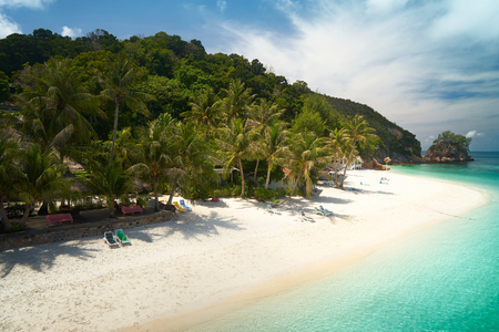 Beautiful beach aerial view over a Rawa island. White sandy beach seen from above. Malaysia .
