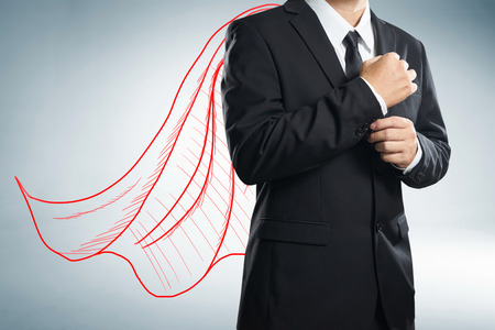 Businessman with drawn red color cape. the concept of success, leadership and victory in business. Stock Photo