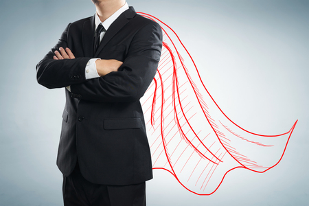 super man: Businessman with drawn red color cape. the concept of success, leadership and victory in business. Stock Photo