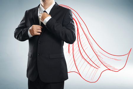 Businessman with drawn red color cape. the concept of success, leadership and victory in business. Reklamní fotografie