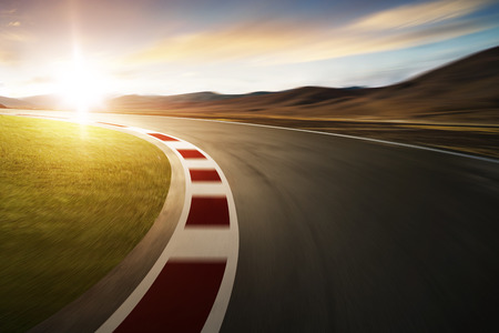 Motion blurred racetrack with mountain background , warm mood