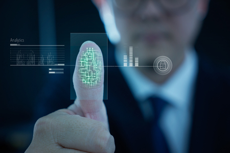 Young businessman scan fingerprint for identity analytics , concept of the internet and future immersive technology for business security . Stock Photo