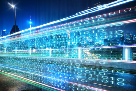 Highway flyover with binary code numbers on motion blurred asphalt  road , speed and faster digital matrix technology information concept . Archivio Fotografico