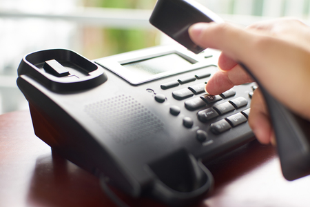 Telephone dialing ,contact and customer service concept . Selected focus .