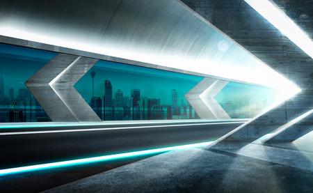 Modern asphalt road in glass tunnel with beautiful city skyline background . Night scene .