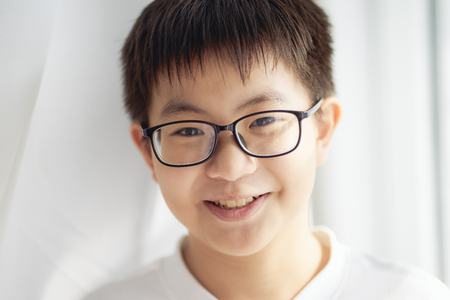 Little asian chinese boy shilly-shally and smile  pose . Standard-Bild