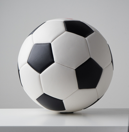 Soccer or football ball close up image on light grey background.