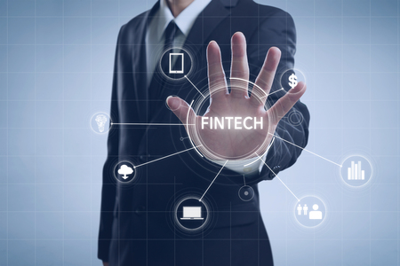 Businessman with fintech icon and internet of things with matrix code background, Investment and financial internet technology concept. Banque d'images