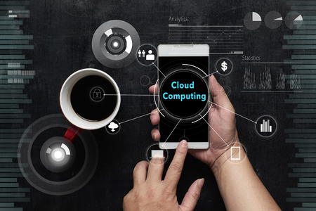 "Man using digital device with ""Cloud Computing"" word on digital virtual screen . Hi-tech business concept ."