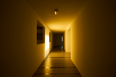 Empty apartment corridor with morning warm light and shadow . Stock Photo