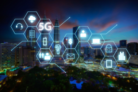 5G network wireless systems and internet of things with blur city background .