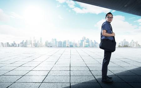 Stressful businessman with city skyline background .