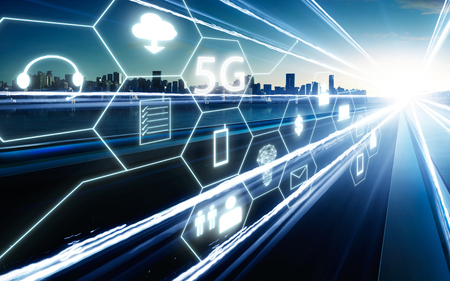 5G network wireless systems and internet of things with  highway overpass motion blur with city skyline background . Stock Photo