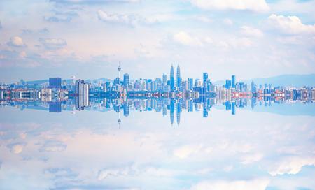 Kuala Lumpur city skyline with stunning reflection in water .