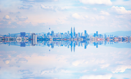 Kuala Lumpur city skyline with stunning reflection in water .