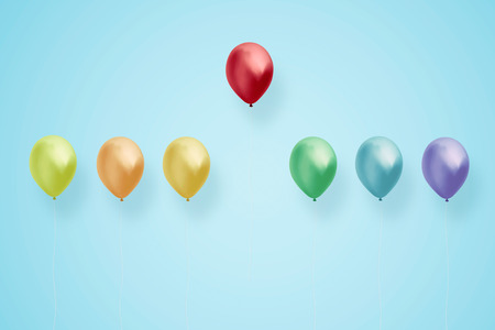 Red balloon fly up from other colorful balloon. Leadership and business success concept . Stock Photo