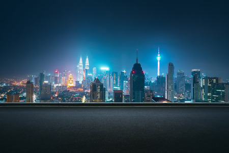 Asphalt road side with beautiful Kuala Lumpur city skyline. Night scene .
